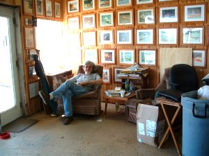 Ray surrounded by pictures of his boats